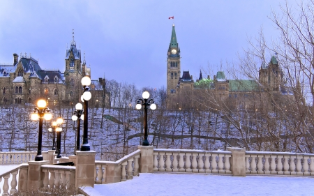 The Canadian Parliament Centre and East Blocks seen from the ornate fence and stairway at Majors Hill Park. Stock Photo