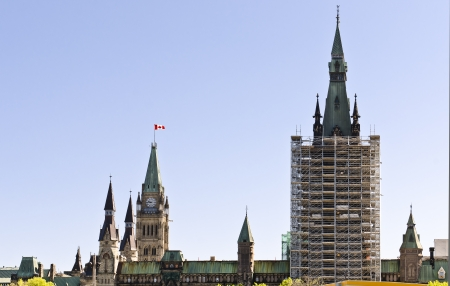The Canadian Parliament West Block under construction and the Centre Block Tower in Ottawa, Canada.