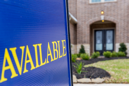 Available sign posted in front a new construction house Stock Photo