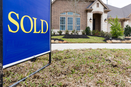 Sold sign posted in front a new construction house Stock Photo