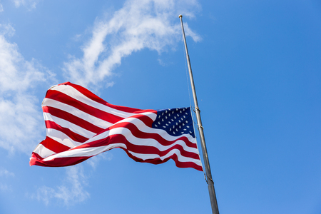United States flag flying at a half-staff