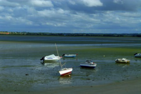 boat lying on the sand at low tide at Saint-Jacut-de-la-Mer, in Brittany
