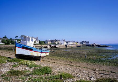 fishing boat at low tide on the Brittany coast