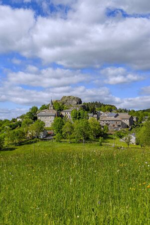 Picturesque village of Queyrieres in the mountains of Auvergne in spring