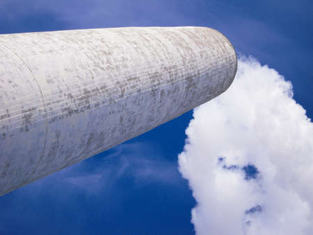 billowing: White smoke stack billowing white smoke on clear blue sky.