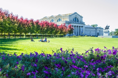 grecian: View of park on a sunny day.  Purple flowers in foreground, Grecian style museum  and trees turning red in background