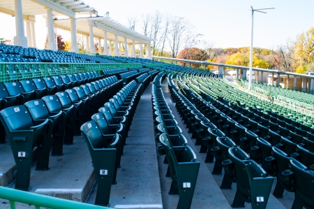 Many rows of empty stadium seating in a large outdoor amphitheater