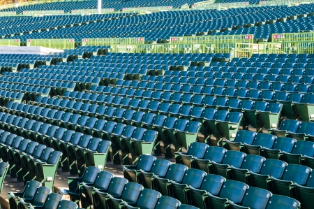 assigned: Many rows of empty stadium seating in a large outdoor amphitheater