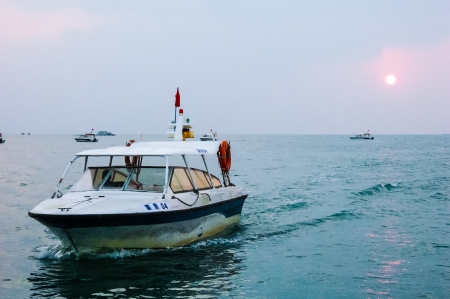 patrolling: Chinese emergency boat patrolling water.