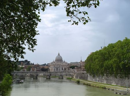St. Peters Basilica and Ponte Sant Angelo at cloudy day Stock Photo