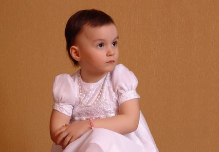 Surprised little girl in pink dress