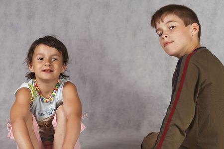 boy and girl sit separately photo