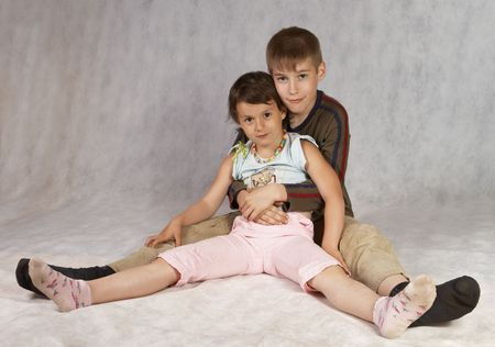 boy and girl riends sit together and hugs photo