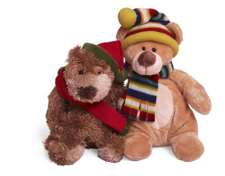 Isolated teddy bear couple sitting at white background. Friends in winter clothing photo