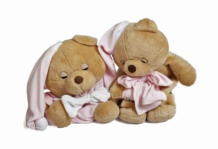 Isolated teddy bear couple sitting at white background. Couple in sleeping clothing Stock Photo
