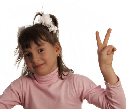 Little pretty girl in pink shirt show victory sign by she's hand photo