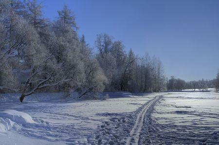 Snow ski road on a frozen lake. North of Russia