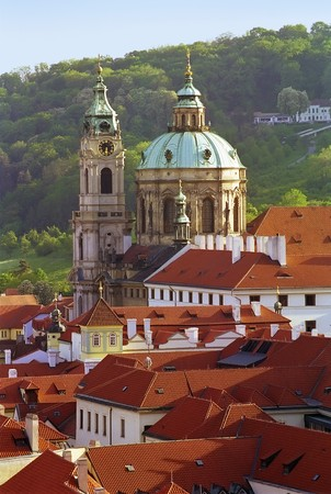 Prague classic view at roofs and dome cathedral in a sun beams