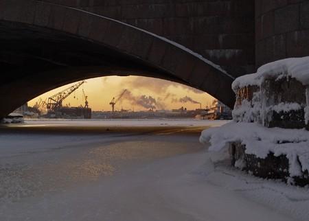 Could Saint-Petersburg. Frozen Neva river, industrial landscape, ships and smoke