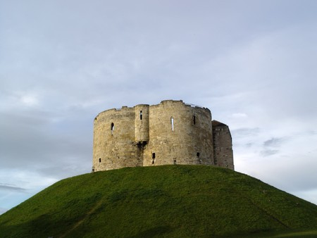 Cliffords Tower on cloudy background. York Castle, York, England.