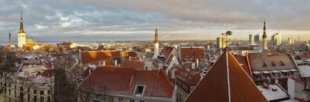 estonia: panoramic view of Tallinn, Estonia, cityscape from the upper city at sunset