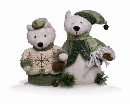 Isolated teddy bear couple holding each other by hand  at white background. Winter clothing