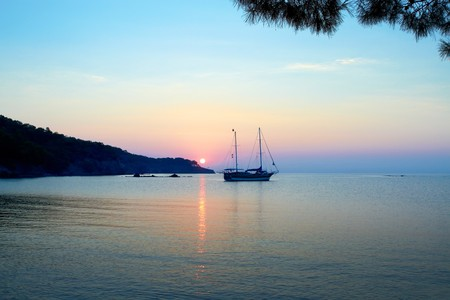 mediterranian: A beautiful Mediterranian sea sunrise with alone ship in the foreground. Stock Photo