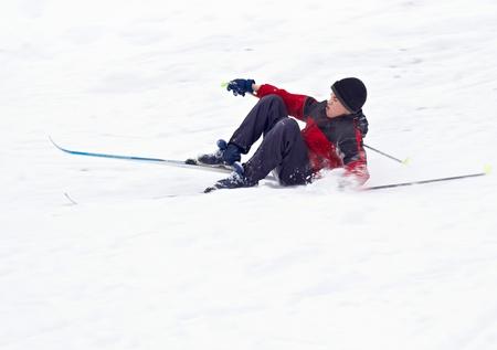 Boy Skier fell on snow Stock Photo
