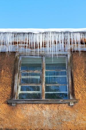 Windows Beneath Icicles Stock Photo - 9209894