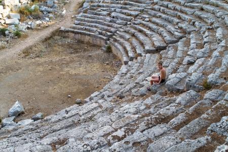 Boy in old greec amphitheater Turkey