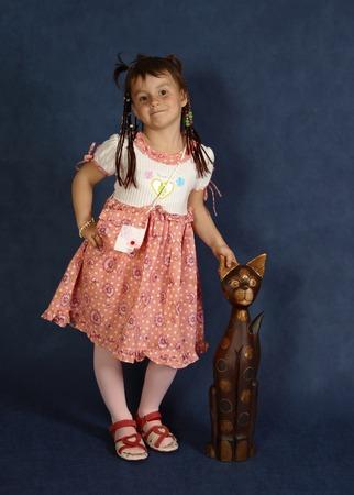 portrait of cute little girl on blue background
