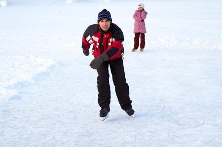 Happy family on skating rink outdoors Stock Photo