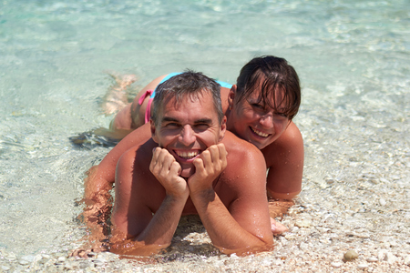 Portrait of cheerful couple in tropical sea Stock Photo