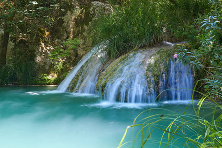 Natural waterfall and lake in Polilimnio area. Greece Editorial