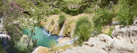 Natural waterfall and lake in Polilimnio area. Greece Stock Photo