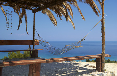 Empty hammock Swing on a tropical beach - vacation background