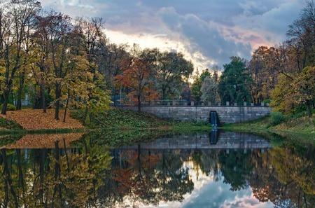 Autumn dark quet lake with stone bridge at evening HDR Stock Photo