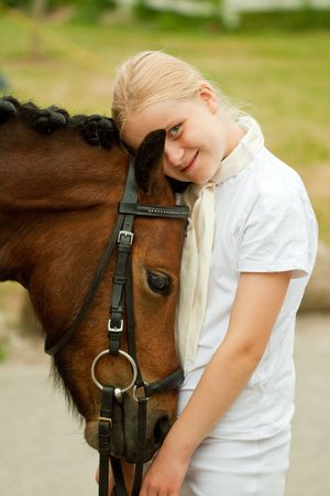 horse blonde: Young girl with her pony