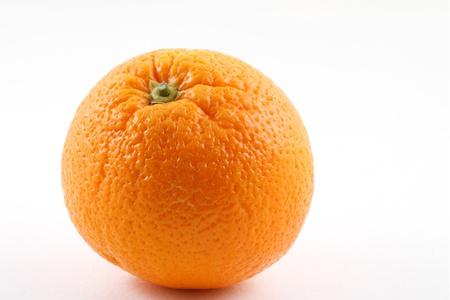 Single orange fruit on white