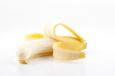 One peeled banana on white Archivio Fotografico