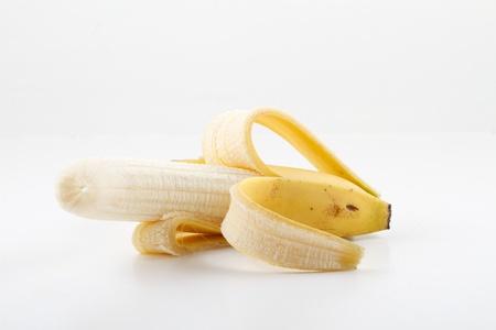 One peeled banana on white Standard-Bild