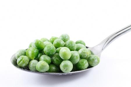 Frozen peas on a spoon photo