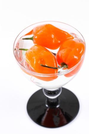 Habanero chili in small glass Archivio Fotografico