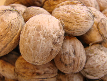 Appetizing Walnut in the shell, eco-friendly, natural, close-up. Many walnuts. Nuts in a box. Texture nuts Stock Photo