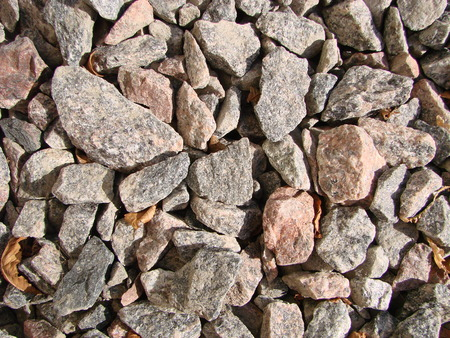 Rocks, small rocks or gravel Used for construction of buildings, roads and for landscaping