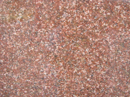 texture, background. The pavement of granite stone. Paved roadway street. any paved area or surface. Old cobblestone road pavement texture, grass between stones