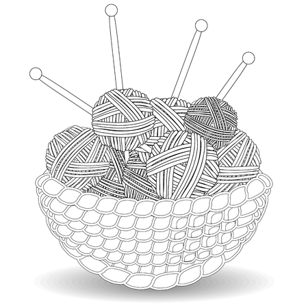 Basket with tangles of balls of wool.