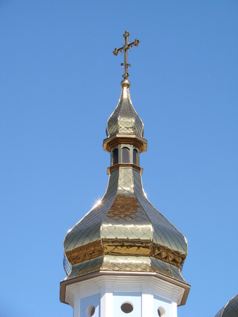 Eastern orthodox crosses on gold domes cupolas againts blue sky with clouds Stock Photo
