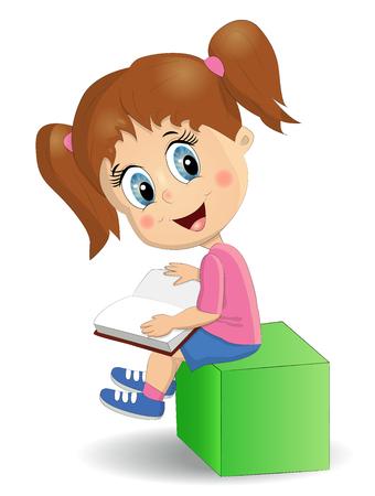 Słodka, zabawna dziewczyna czyta książkę siedząc na zielonej kostce