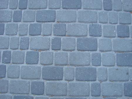 Pavimentazione in pietra texture. Sfondo di pavimentazione in ciottoli di granito. Sfondo astratto del vecchio primo piano pavimentazione in ciottoli.